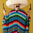 Bandit Mexican revolver mustache gunman sombrero — Stock Photo #5600397
