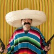 Bandit Mexican revolver mustache gunman sombrero — Stock Photo #5600401
