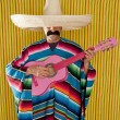 Mexican man serape poncho sombrero playing guitar — Photo