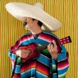 Mexican man serape poncho sombrero playing guitar — Stock Photo #5600423