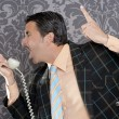 Angry nerd businessman retro telephone call shouting — Stock Photo #5600515