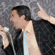 Stock Photo: Angry nerd businessman retro telephone call shouting
