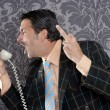 Angry nerd businessman retro telephone call shouting - Stock Photo