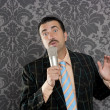 Nerd retro mustache man microphone singing silly - Stock Photo