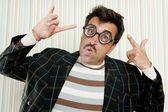 Nerd silly crazy myopic glasses man funny gesture — Stock Photo