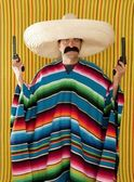 Bandit Mexican revolver mustache gunman sombrero — Stock Photo