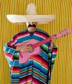 Mexican man serape poncho sombrero playing guitar — Stock Photo