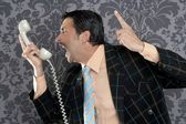 Angry nerd businessman retro telephone call shouting — Stock Photo