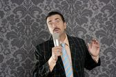 Nerd retro mustache man microphone singing silly — Stock Photo