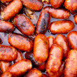 Chorizo red sausages fried in oil — Stock Photo