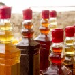 Stock Photo: Colorful traditional liquor bottles in rows
