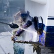 Stock Photo: Blue boat hull cleaning pressure washer barnacles