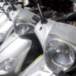 Bikes motorbikes motorcycles rows in a renting - Stock Photo