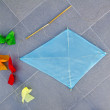 Blue children kite traditional diamond shape on floor — Stock Photo