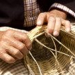 Stock Photo: Basketry craftsmhands working in Mediterranebasket