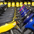 Stock Photo: Bikes motorbikes motorcycles rows in renting