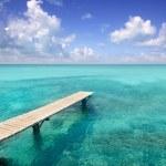 Illeta wooden pier turquoise sea Formentera — Stock Photo