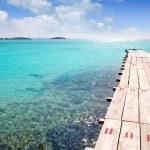 Formentera beach wood pier turquoise balearic sea — Stock Photo