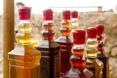 Colorful traditional liquor bottles in rows — Stock Photo