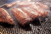 BBQ ribs grilled meat smoke fog barbecue — Stock Photo