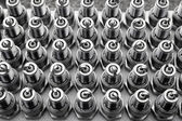 Car spark plugs rows pattern mechanical engine pieces — Stock Photo