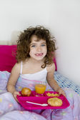 Awakening bed breakfast brunette children girl — Stock Photo