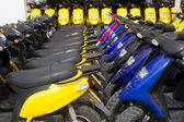 Bikes motorbikes motorcycles rows in a renting — Stock Photo