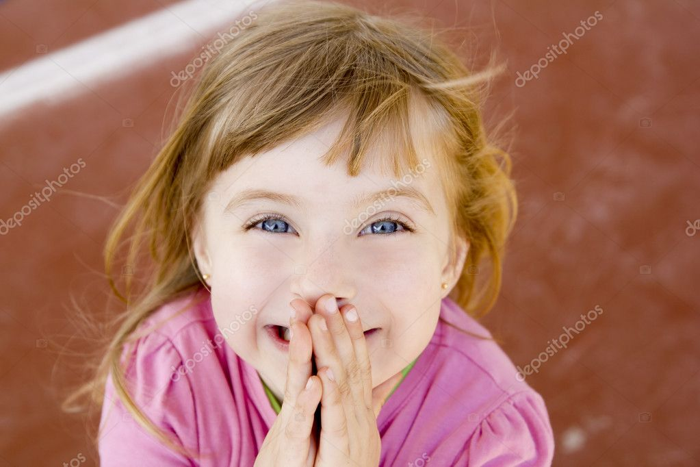 Blond happy smiling little girl excited laugh hands in mouth  Stock Photo #5711644