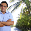 Indian latin tourist man in tropical palm tree caribbean — Stock Photo #5808465