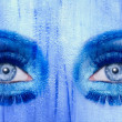 Abstract blue eyes makeup woman grunge texture - Stock Photo