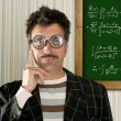 Genius nerd glasses silly man board math formula — Stock Photo