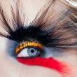 black bird woman eye makeup macro palm tree beach — Stock Photo