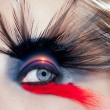 Black bird woman eye makeup macro beach sunrise — Stock Photo