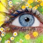 Blue woman eye makeup spring flowers metaphor — Stock Photo #5809203