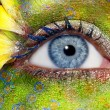 Blue woman eye makeup spring flowers metaphor - Stockfoto