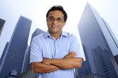 American businessman indian latin urban city buildings — Stock fotografie