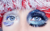 Christmas concept eye makeup winter red silver macro — Stock Photo