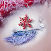 Christmas star concept eye makeup winter red silver — Stock Photo