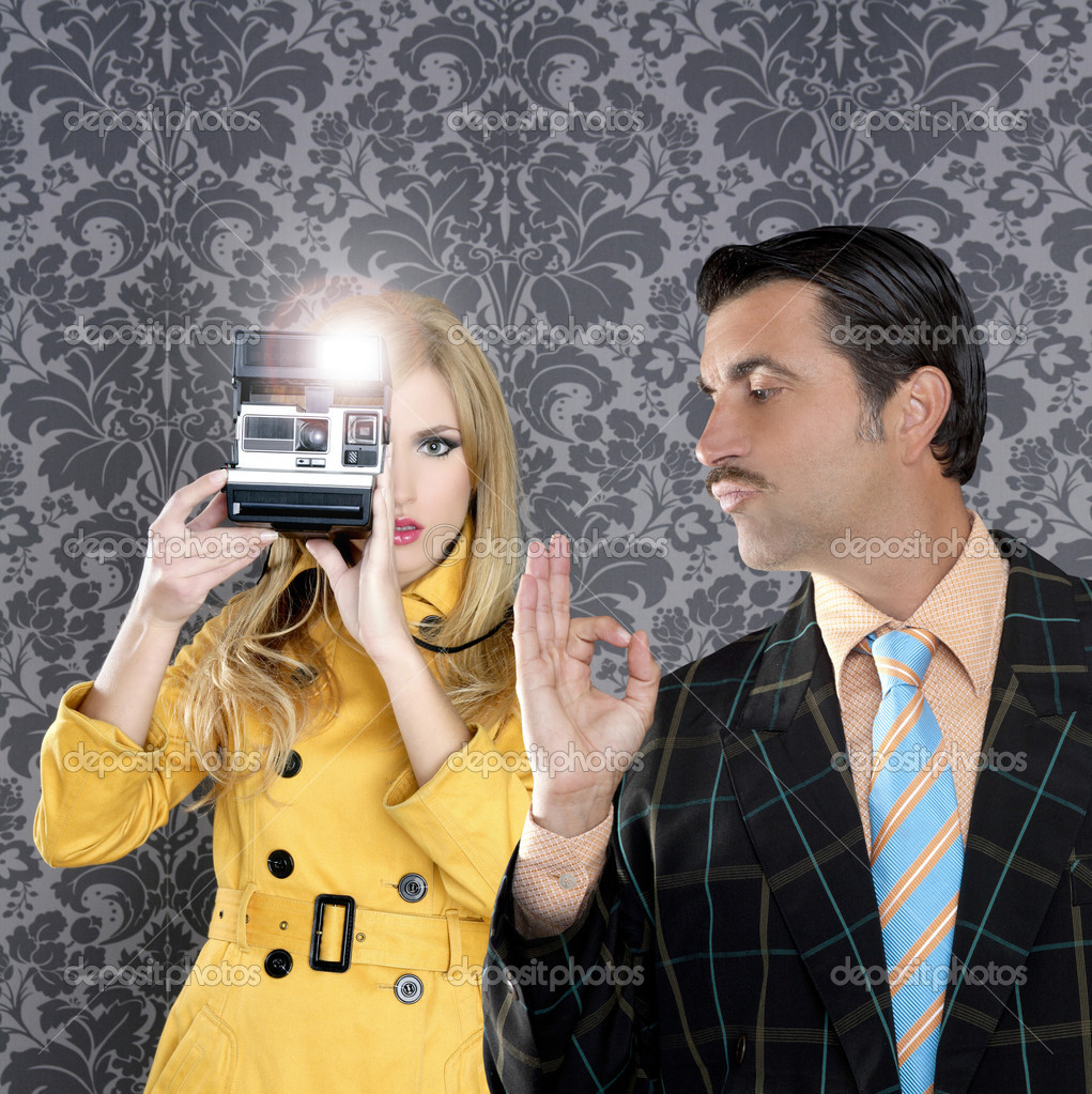 Geek tacky mustache man reporter fashion girl photo shoot retro wallpaper — Stock Photo #5808784