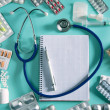 Doctor desk workplace stethoscope spiral notebook - Stok fotoğraf