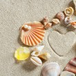Beach white sand heart shape print summer vacation — Stock Photo #5935402