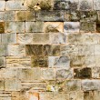 Mares sandstone stone masonry wall in Majorca - Stock Photo