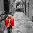 Mediterranean street with old retro red scooter in Mallorca — Stock Photo