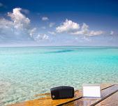 Car rental keys on wood table in vacation Caribbean — Stock Photo