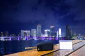 Car rental keys on wood table in Miami night — Stock Photo