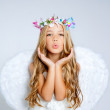 Angel little girl blowing expression with wings — Stock Photo #6213267