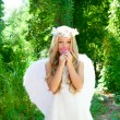 Stock Photo: Angel children girl smelling pinks flower in forest