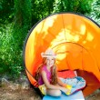 Royalty-Free Stock Photo: Camping children girl with hat in forest tent outdoor
