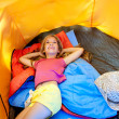 Children girl lying on camping tent floor in vacation — Stock Photo #6214104