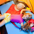 Children girl lying on camping tent floor in vacation — Stock Photo
